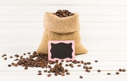 Jute bag of roasted coffee with small chalkboard Stock Photos
