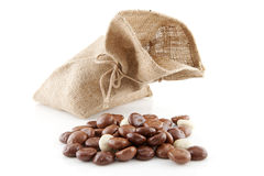 Jute bag with typical dutch sweets: chocolate pepernoten (ginger Stock Image