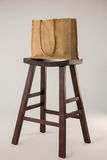 Jute bag on wooden stool Stock Photography