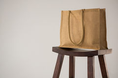 Jute bag on wooden stool Royalty Free Stock Images