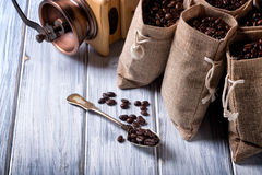 Jute bags with coffee beans and grinder Stock Photo