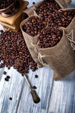 Jute bags with coffee beans and grinder Royalty Free Stock Image