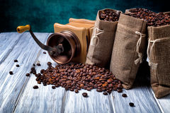 Jute bags with coffee beans and grinder Royalty Free Stock Photography