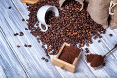 Jute bags with coffee beans and grinder Stock Image