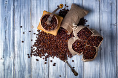 Jute bags with coffee beans and grinder Stock Photos