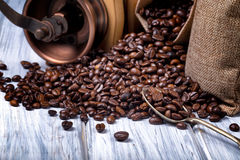 Jute bags with coffee beans and grinder Stock Photography