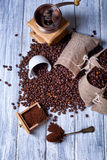 Jute bags with coffee beans and grinder Stock Images