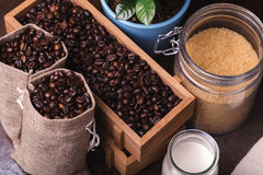Jute bags with coffee beans, milk and sugar Royalty Free Stock Image