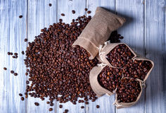 Jute bags filled with coffee beans Royalty Free Stock Image