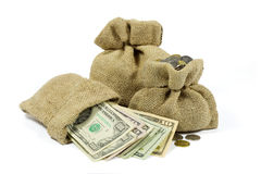 Jute Bags Full of Money Isolated on White Royalty Free Stock Photos