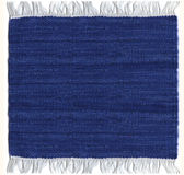 Blue Jute carpet. Isolated jute blue carpet with fringes Royalty Free Stock Photography