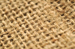 Jute cloth macro. Macro detail of brown jute fabric royalty free stock images