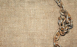 Jute cloth with old chain Stock Images