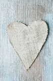Jute heart. A jute cloth heart on a painted background Royalty Free Stock Photos