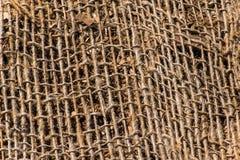 Jute mesh. A background texture of burlap cloth rough jute mesh Royalty Free Stock Photo