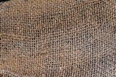 Jute mesh. A background texture of burlap cloth rough jute mesh Stock Photography