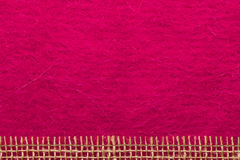 Jute mesh over pink background Royalty Free Stock Image