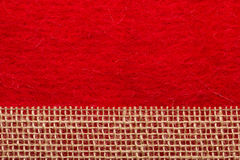 Jute mesh over red background Royalty Free Stock Photo