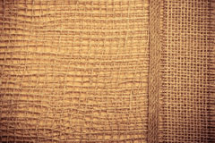 Jute ribbon on burlap cloth background Royalty Free Stock Photos