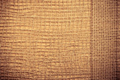 Jute ribbon on burlap cloth background Royalty Free Stock Image