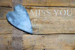 Jute ribbon and heart on wooden table, miss you Royalty Free Stock Photography