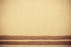 Jute ribbon on linen cloth background Royalty Free Stock Photography