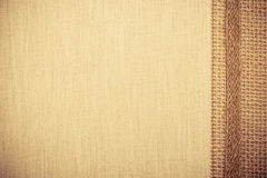 Jute ribbon on linen cloth background Stock Photos