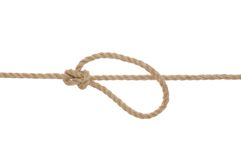 Jute Rope with Bowline Knot. A jute rope with a bowline knot and loop on a white background royalty free stock photo