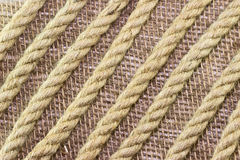 Jute rope on burlap background Royalty Free Stock Photos