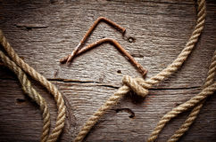 Jute rope on decrepit wooden log Stock Images