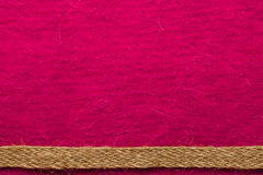 Jute rope over pink background Royalty Free Stock Images
