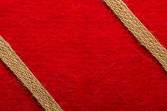 Jute rope over red background Stock Images