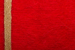 Jute rope over red background Royalty Free Stock Photos