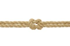 Jute Rope with Reef Knot. On white background royalty free stock images