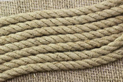Jute rope on sackcloth Stock Image