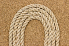 Jute rope on the sea sand. Background Royalty Free Stock Photos