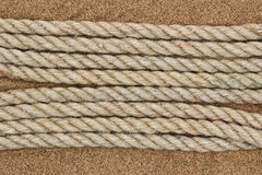 Jute rope on the sea sand Royalty Free Stock Photo