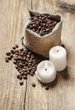 Jute sack of coffee beans on wooden table Royalty Free Stock Photos