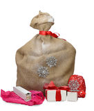 Jute sack with gift boxes and presents stock images