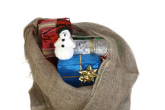 Jute sack with gifts Royalty Free Stock Photo