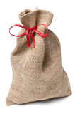 Jute sack present with red ribbon Stock Photos