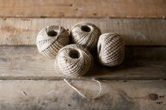 Jute Strings on wooden table Stock Photography