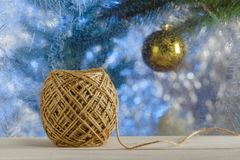 Jute twine for wrapping Christmas gifts. Sill frosty Windows. Blurred background. A rustic style. Jute twine for wrapping Christmas gifts. Sill frosty Windows stock images