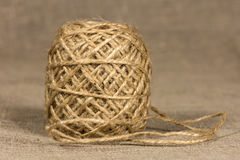 Jute yarn coiling into a ball Royalty Free Stock Image