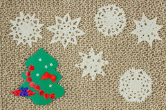 Jute yarn knitted fabric. Snowflakes, Christmas Tree. Stock Photo