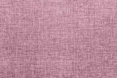 Juteachtergrond in bleek wordt gekleurd - roze mengsel dat royalty-vrije stock afbeeldingen