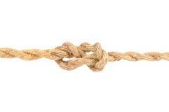 Jutefaser-Seil mit Wirsing-Knoten auf weißem Hintergrund Lizenzfreie Stockbilder