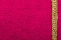 Jutefaserseil über rosa Hintergrund lizenzfreie stockbilder