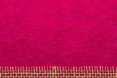 Jutenetwerk over roze achtergrond Royalty-vrije Stock Afbeelding