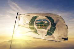 Jutiapa Department of Guatemala flag textile cloth fabric waving on the top sunrise mist fog. Beautiful stock photos